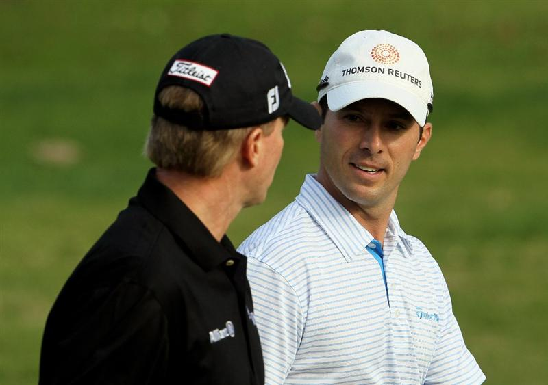 PACIFIC PALISADES, CA - FEBRUARY 04:  Mike Weir of Canada talks with Steve Stricker during the first round of the Northern Trust Open at Riviera Country Club on February 4, 2010 in Pacific Palisades, California.  (Photo by Jeff Gross/Getty Images)