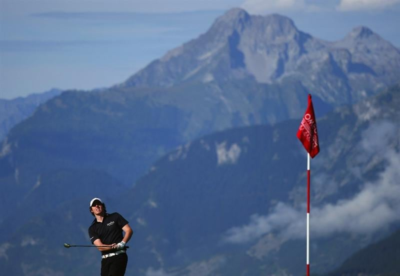 CRANS, SWITZERLAND - SEPTEMBER 05:  Rory McIlroy of Northern Ireland plays a chip shot on the seventh hole during the second round of the Omega European Masters at Crans-Sur-Sierre Golf Club on September 5, 2008 in Crans Montana, Switzerland.  (Photo by Andrew Redington/Getty Images)