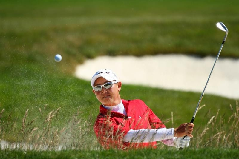 PEBBLE BEACH, CA - JUNE 16:  Toru Taniguchi of Japan hits a bunker shot during a practice round prior to the start of the 110th U.S. Open at Pebble Beach Golf Links on June 16, 2010 in Pebble Beach, California.  (Photo by Donald Miralle/Getty Images)