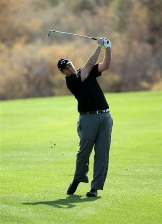 LA QUINTA, CA - JANUARY 19:  J.J. Henry hits his second shot on the 16th hole during round one of the Bob Hope Classic at the Nicklaus Private Course at PGA West on January 19, 2011 in La Quinta, California.  (Photo by Stephen Dunn/Getty Images)