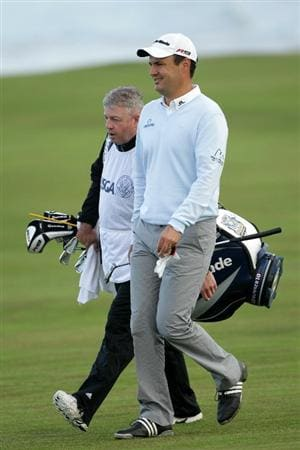 PEBBLE BEACH, CA - JUNE 17:  Simon Khan of England (R) walks with his caddie Stan Mercer on the tenth hole during the first round of the 110th U.S. Open at Pebble Beach Golf Links on June 17, 2010 in Pebble Beach, California.  (Photo by Andrew Redington/Getty Images)
