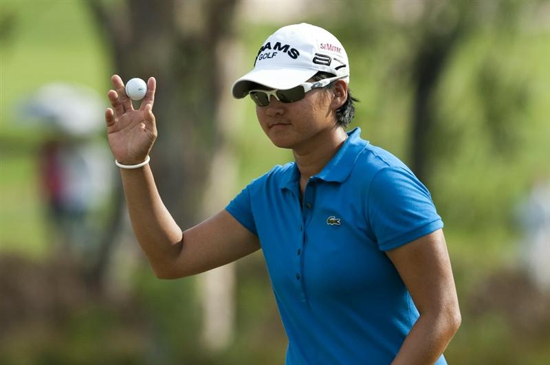 CHON BURI, THAILAND - FEBRUARY 19:  Yani Tseng of Taiwan acknowledges to the crowd on the 15th green during day three of the LPGA Thailand at Siam Country Club on February 19, 2011 in Chon Buri, Thailand.  (Photo by Victor Fraile/Getty Images)