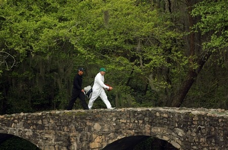 AUGUSTA, GA - APRIL 08:  Tiger Woods walks with caddie Steve Williams over the Byron Nelson bridge during the second day of practice prior to the start of the 2008 Masters Tournament at Augusta National Golf Club on April 8, 2008 in Augusta, Georgia.  (Photo by Harry How/Getty Images)