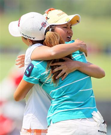 SINGAPORE - FEBRUARY 28:  Ai Miyazato of Japan hugs Momoko Ueda (R) of Japan after winning the HSBC Women's Champions at Tanah Merah Country Club on February 28, 2010 in Singapore, Singapore.  (Photo by Andy Lyons/Getty Images)