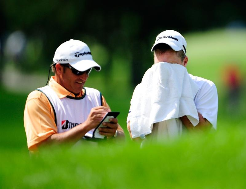 AKRON, OH - AUGUST 07:  Scott Verplank wipes his face during the second round of the WGC-Bridgestone Invitational on the South Course at Firestone Country Club on August 7, 2009 in Akron, Ohio.  (Photo by Sam Greenwood/Getty Imges)