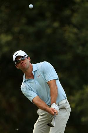 PONTE VEDRA BEACH, FL - MAY 13:  Paul Casey of England hits an approach shot on the fourth hole during the second round of THE PLAYERS Championship held at THE PLAYERS Stadium course at TPC Sawgrass on May 13, 2011 in Ponte Vedra Beach, Florida.  (Photo by Streeter Lecka/Getty Images)