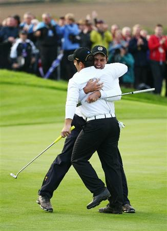 NEWPORT, WALES - OCTOBER 03:  Francesco Molinari of Europe celebrates holing a putt for victory in his match on the 18th green with Edoardo Molinari (R) during the  Fourball & Foursome Matches during the 2010 Ryder Cup at the Celtic Manor Resort on October 3, 2010 in Newport, Wales.  (Photo by Richard Heathcote/Getty Images)