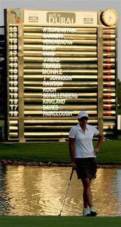 DUBAI, UNITED ARAB EMIRATES - DECEMBER 12:  Nikki Garrett of Australia waits to putt on the 9th green as the setting sun reflects on the player's names at the end of play in the second round of the Dubai Ladies Masters on the Majilis Course at the Emirates Golf Club on December 12, 2008 in Dubai,United Arab Emirat es  (Photo by David Cannon/Getty Images)