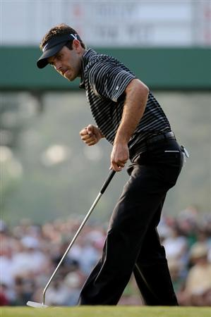 AUGUSTA, GA - APRIL 10:  Charl Schwartzel of South Africa celebrates a birdie putt on the 17th green during the final round of the 2011 Masters Tournament on April 10, 2011 in Augusta, Georgia.  (Photo by Harry How/Getty Images)