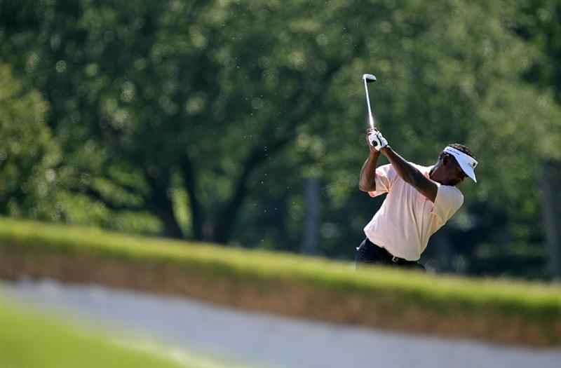 FT. WORTH, TX - MAY 28: Vijay Singh of Fiji Islands hits his second shot on the 1st hole during the first round of the Crowne Plaza Invitational at Colonial Country Club on May 28, 2009 in Ft. Worth, Texas. (Photo by Hunter Martin/Getty Images)