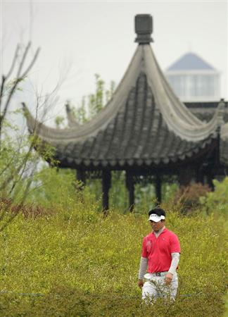 SUZHOU, CHINA - APRIL 18:  Y.E. Yang of Korea walks to the 6th green during the Round Four of the Volvo China Open on April 18, 2010 in Suzhou, China.  (Photo by Victor Fraile/Getty Images)