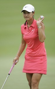 Grace Park waves to the crowd on the fifth green during the second round of the Fields Open in Hawaii golf tournament February 24, 2006 at the Ko Olina Resort Golf Club in Kapolei, on the island of Oahu, Hawaii.Photo by Marco Garcia/WireImage.com