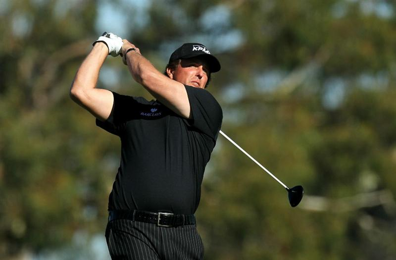 LA JOLLA, CA - JANUARY 27:  Phil Mickelson hits his tee shot on the second hole during round one of the Farmers Insurance Open at Torrey Pines North Course on January 27, 2011 in La Jolla, California.  (Photo by Stephen Dunn/Getty Images)