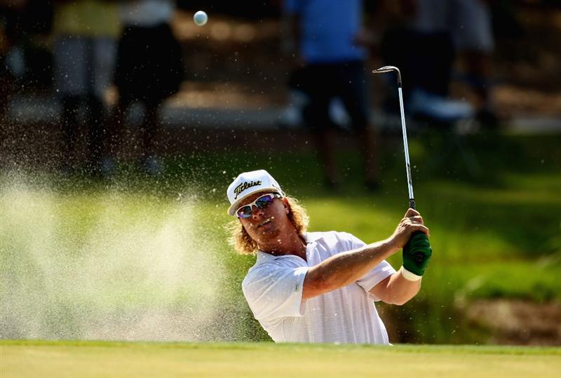 PONTE VEDRA BEACH, FL - MAY 08:  Charley Hoffman plays from a greenside bunker on the 11th hole during the third round of THE PLAYERS Championship held at THE PLAYERS Stadium course at TPC Sawgrass on May 8, 2010 in Ponte Vedra Beach, Florida.  (Photo by Richard Heathcote/Getty Images)