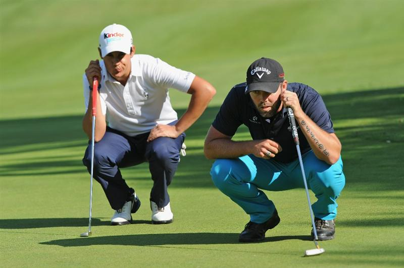CASTELLON DE LA PLANA, SPAIN - OCTOBER 23:  Matteo Manassero of Italy and Christian Nilsson of Sweden line up their putts on the 10th hole during the third round of the Castello Masters Costa Azahar at the Club de Campo del Mediterraneo on October 23, 2010 in Castellon de la Plana, Spain.  (Photo by Stuart Franklin/Getty Images)