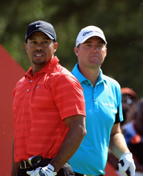 Tiger Woods and Peter Hanson