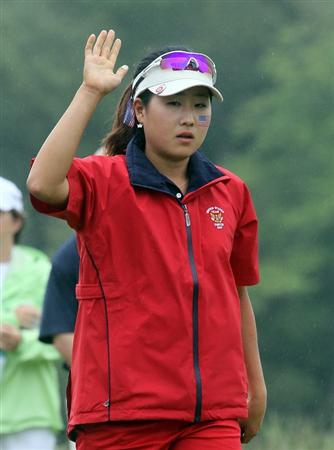 MANCHESTER, MA - JUNE 12:  Jennifer Song of the United States reacts after sinking a putt  in Four Ball competition during the second day of the 2010 Curtis Cup Match at the Essex Country Club on June 12, 2010 in Manchester, Massachusetts. (Photo by Jim Rogash/Getty Images)