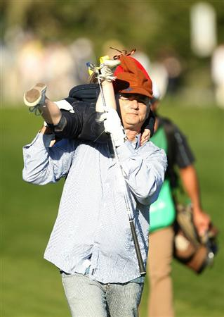 PEBBLE BEACH, CA - FEBRUARY 12:  Actor Bill Murray carries a girl that he picked from the crowd down the 17th fairway during the third round of the AT&T Pebble Beach National Pro-Am at the Pebble Beach Golf Links on February 12, 2011 in Pebble Beach, California.  (Photo by Ezra Shaw/Getty Images)