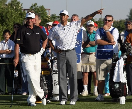 DUBAI, UNITED ARAB EMIRATES - JANUARY 29:  Tiger Woods of the USA and Darren Clarke of Northern Ireland on the 8th tee during the Dubai Desert Classic Challenge Match, held on the par 3, course at the Emirates Golf Club, on January 29, 2007 in Dubai, United Arab Emirates.  (Photo by David Cannon/Getty Images)