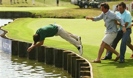 VERSAILLES, FRANCE - JUNE 29:  Pablo Larrazabal of Spain is pushed into the water by fellow Spanish golfers after winning the Open de France ALSTOM at the Le Golf National Golf Club on June 29, 2008 in Versailles, France.  (Photo by Warren Little/Getty Images)
