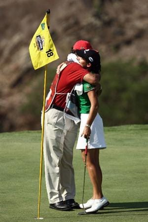 MORELIA, MEXICO- APRIL 26:  Lorena Ochoa of Mexico hugs caddie Rafael Quiroz after her 25-under par victory during the final round of the Corona Championship at the Tres Marias Residential Golf Club on April 26, 2009 in Morelia, Michoacan, Mexico. (Photo by Donald Miralle/Getty Images)