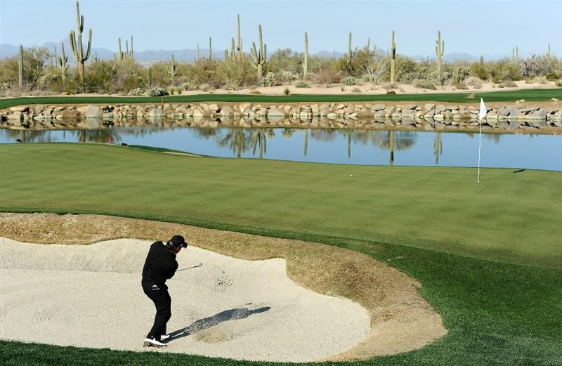 MARANA, AZ - FEBRUARY 24:  Graeme McDowell of Northern Ireland hits from a greenside bunker on the third hole during the second round of the Accenture Match Play Championship at the Ritz-Carlton Golf Club on February 24, 2011 in Marana, Arizona.  (Photo by Stuart Franklin/Getty Images)