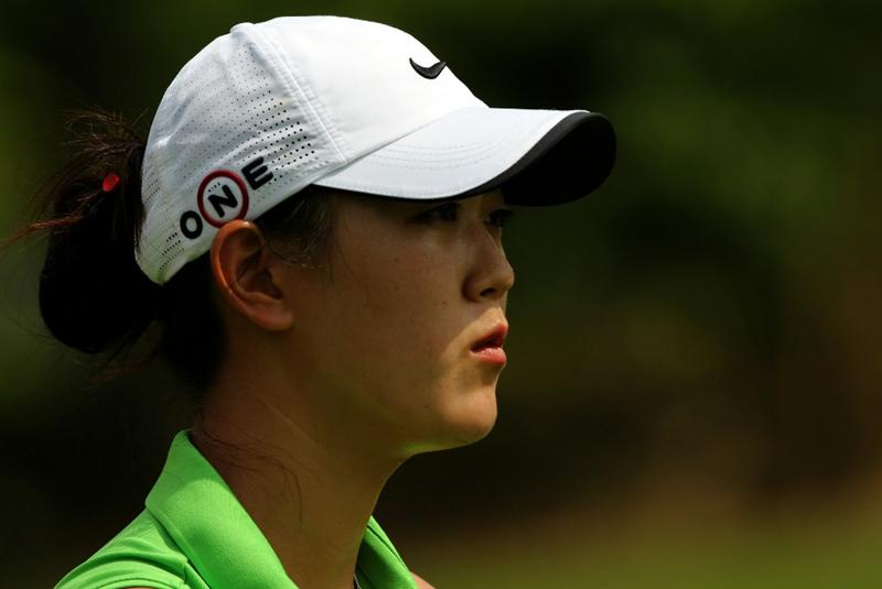 KUALA LUMPUR, MALAYSIA - OCTOBER 21: Michelle Wie of USA in deep thoughts on the 5th hole during the Sime Darby Pro-Am at the KLGCC Golf Course on October 21, 2010 in Kuala Lumpur, Malaysia.  (Photo by Stanley Chou/Getty Images)
