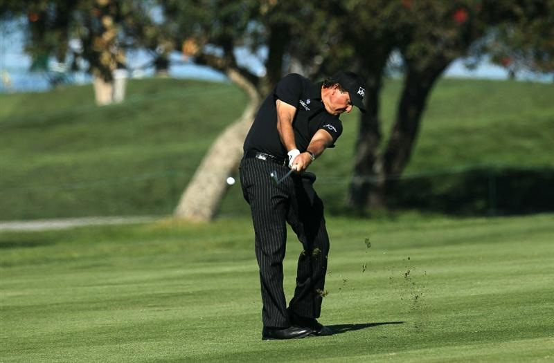 LA JOLLA, CA - JANUARY 27:  Phil Mickelson hits his second shot on the fifth hole during round one of the Farmers Insurance Open at Torrey Pines North Course on January 27, 2011 in La Jolla, California.  (Photo by Stephen Dunn/Getty Images)