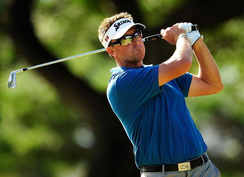 HONOLULU,HI - JANUARY 16:  Robert Allenby of Australia plays a shot on the 8th hole during the third round of the Sony Open at Waialae Country Club on January 16, 2010 in Honolulu, Hawaii.  (Photo by Sam Greenwood/Getty Images)
