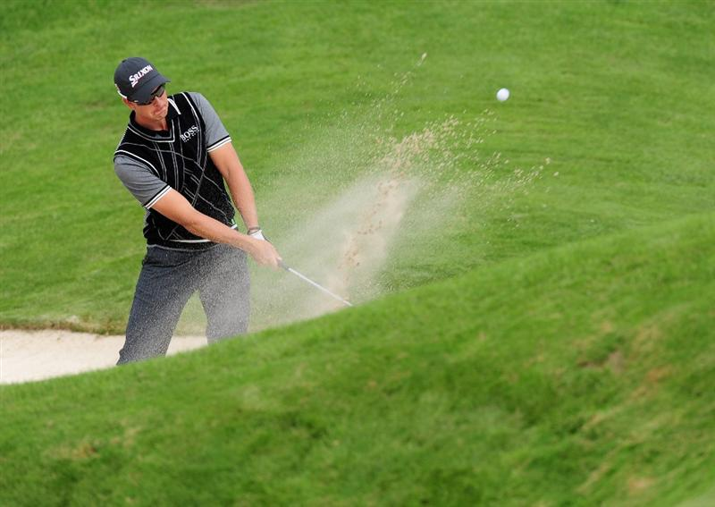 COLOGNE, GERMANY - SEPTEMBER 11:  Henrik Stenson of Sweden plays his bunker shot on the 13th hole during the second round of The Mercedes-Benz Championship at The Gut Larchenhof Golf Club on September 11, 2009 in Cologne, Germany.  (Photo by Stuart Franklin/Getty Images)