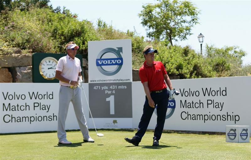 CASARES, SPAIN - MAY 22:  Luke Donald of England (right) watches his tee-shot on the first hole as Ian Poulter of England looks on during the final of the Volvo World Match Play Championship at Finca Cortesin on May 22, 2011 in Casares, Spain.  (Photo by Andrew Redington/Getty Images)