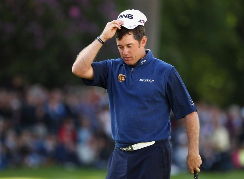 VIRGINIA WATER, ENGLAND - MAY 29:  Lee Westwood of England looks dejected after missing a birdie putt on the 18th green during the final round of the BMW PGA Championship  at the Wentworth Club on May 29, 2011 in Virginia Water, England.  (Photo by Richard Heathcote/Getty Images)