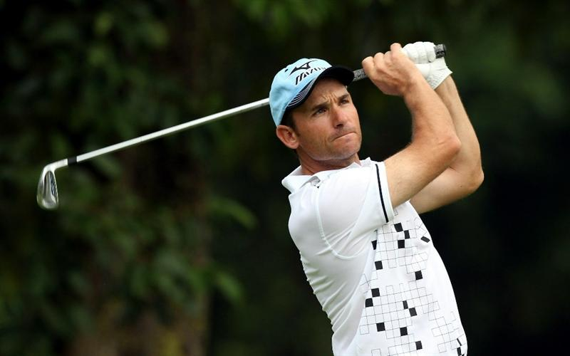 SINGAPORE, NOVEMBER 12 : Ignacio Garrido of Spain watche his tee shot on the 14th hole during the delayed first round of the Barclays Singapore Open held at the Sentosa Golf Club on November 12, 2010 Singapore. (Photo by Stanley Chou/Getty Images)