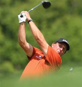 AKRON, OH - AUGUST 03:  Phil Mickelson of USA plays his tee shot on the sixth hole during final round of the World Golf Championship Bridgestone Invitational on August 3, 2008 at Firestone Country Club in Akron, Ohio.  (Photo by Stuart Franklin/Getty Images)