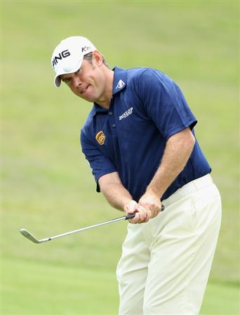 CASARES, SPAIN - MAY 19:  Lee Westwood of England chips onto the second green against Anders Hansen of Denmark during the group stages of the Volvo World Match Play Championships at Finca Cortesin on May 19, 2011 in Casares, Spain.  (Photo by Warren Little/Getty Images)