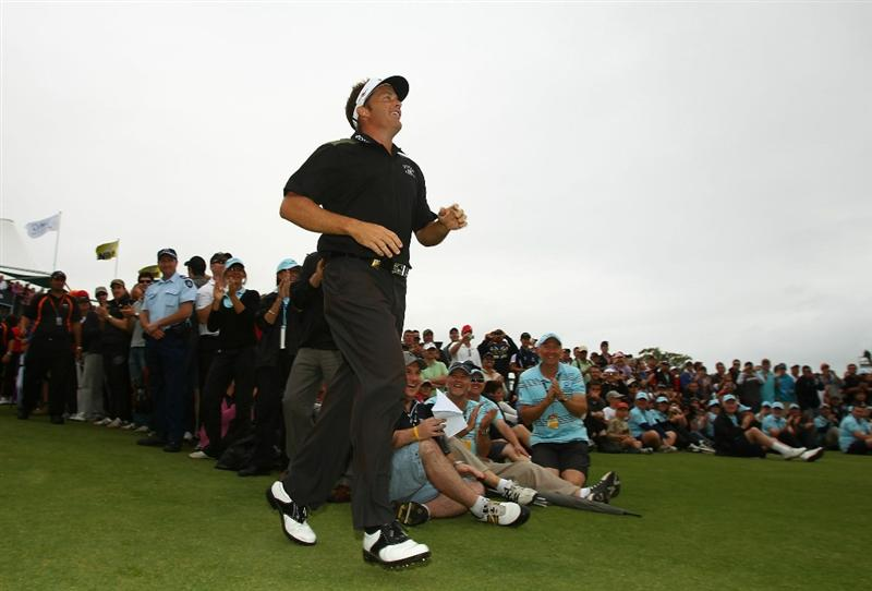 MELBOURNE, AUSTRALIA - NOVEMBER 14:  Stuart Appleby of Australia runs onto the green to accept the winners trophy after he won the Australian Masters at The Victoria Golf Club on November 14, 2010 in Melbourne, Australia.  (Photo by Robert Cianflone/Getty Images)