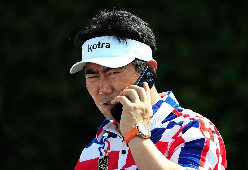 KAPALUA, HI - JANUARY 08:  Y.E. Yang of Korea talks on a cell phone prior to the second round of the SBS Championship at the Plantation course on January 8, 2010 in Kapalua, Maui, Hawaii.  (Photo by Sam Greenwood/Getty Images)