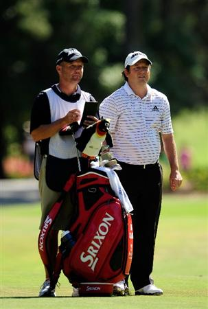 PONTE VEDRA BEACH, FL - MAY 09:  Tim Clark of South Africa (R) waits on the tenth fairway with his caddie Steve Underwood during the final round of THE PLAYERS Championship held at THE PLAYERS Stadium course at TPC Sawgrass on May 9, 2010 in Ponte Vedra Beach, Florida.  (Photo by Sam Greenwood/Getty Images)