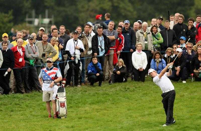 NEWPORT, WALES - OCTOBER 02:  Hunter Mahan of the USA hits a shot on the 4th hole as his caddie John Wood looks on during the rescheduled Afternoon Foursome Matches during the 2010 Ryder Cup at the Celtic Manor Resort on October 2, 2010 in Newport, Wales.  (Photo by Ross Kinnaird/Getty Images)