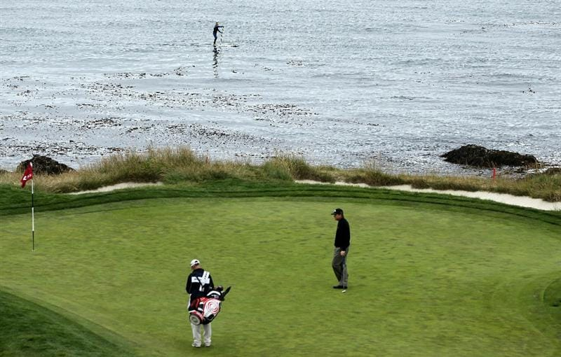 PEBBLE BEACH, CA - JUNE 18:  Shaun Micheel waits on the seventh green with his caddie Stephen Johnson during the second round of the 110th U.S. Open at Pebble Beach Golf Links on June 18, 2010 in Pebble Beach, California.  (Photo by Jeff Gross/Getty Images)