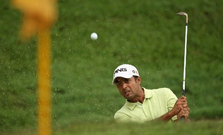 KUALA LUMPUR, MALAYSIA - MARCH 09:  Arjun Atwal of India plays a chip shot during the final round of the Maybank Malaysian Open held at the Kota Permai Golf & Country Club on March 9, 2008 in Kuala Lumpur, Malaysia  (Photo by Ross Kinnaird/Getty Images)