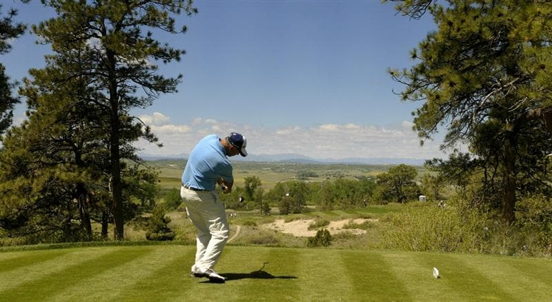 PARKER, CO. - MAY 30: Tom Lehman tees off the 3rd hole during the fourth and final round of the 71st Senior PGA Championship at the Colorado Golf Club on May 30, 2010 in Parker, Colorado.  (Photo by Marc Feldman/Getty Images)