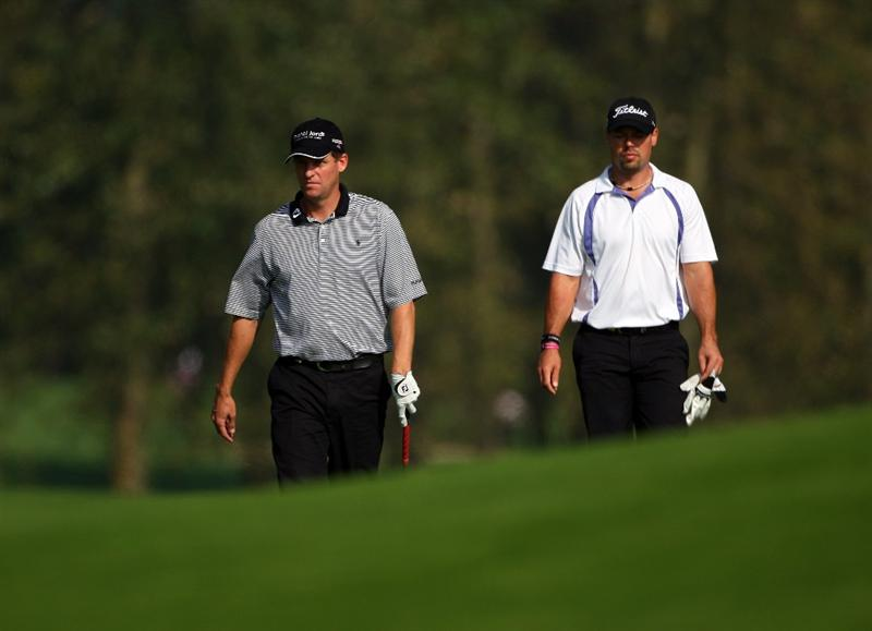 SUTTON COLDFIELD, UNITED KINGDOM - SEPTEMBER 26:  Anders Hansen of Denmark (left) walks with Mikael Lundberg of Sweden on the 16th hole during the second round of the Quinn Insurance British Masters on the Brabazon Course at The Belfry on September 26, 2008 in Sutton Coldfield, England.  (Photo by Andrew Redington/Getty Images)