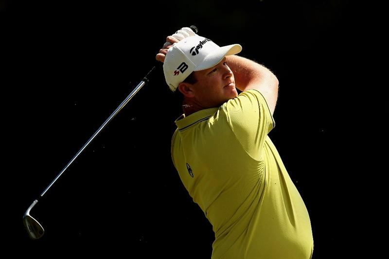 MELBOURNE, AUSTRALIA - NOVEMBER 30:  Marcus Fraser of Australia plays his second shot on the fourteenth hole during the fourth round of the 2008 Australian Masters at Huntingdale Golf Club on November 30, 2008 in Melbourne, Australia  (Photo by Quinn Rooney/Getty Images)