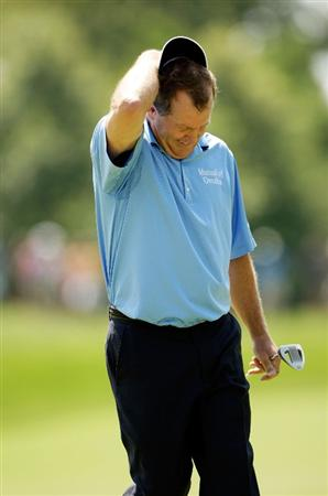 CARMEL, IN - AUGUST 02:  Fred Funk of the USA reacts after just missing a putt on the 5th hole during the final round of the 2009 U.S. Senior Open on August 2, 2009 at Crooked Stick Golf Club in Carmel, Indiana.  (Photo by Jamie Squire/Getty Images)