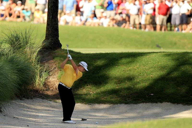 PONTE VEDRA BEACH, FL - MAY 15:  David Toms his his second shot on the tenth hole from a bunker during the final round of THE PLAYERS Championship held at THE PLAYERS Stadium course at TPC Sawgrass on May 15, 2011 in Ponte Vedra Beach, Florida.  (Photo by Streeter Lecka/Getty Images)