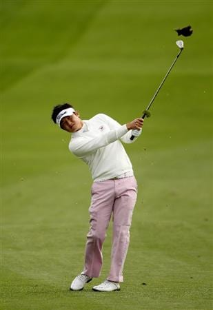 PEBBLE BEACH, CA - FEBRUARY 11:  Ryuji Imada of Japan hits his approach shot on the first hole during the first round of the AT&T Pebble Beach National Pro-Am at at the Spyglass Hill Golf Course on February 11, 2010 in Pebble Beach, California.  (Photo by Ezra Shaw/Getty Images)
