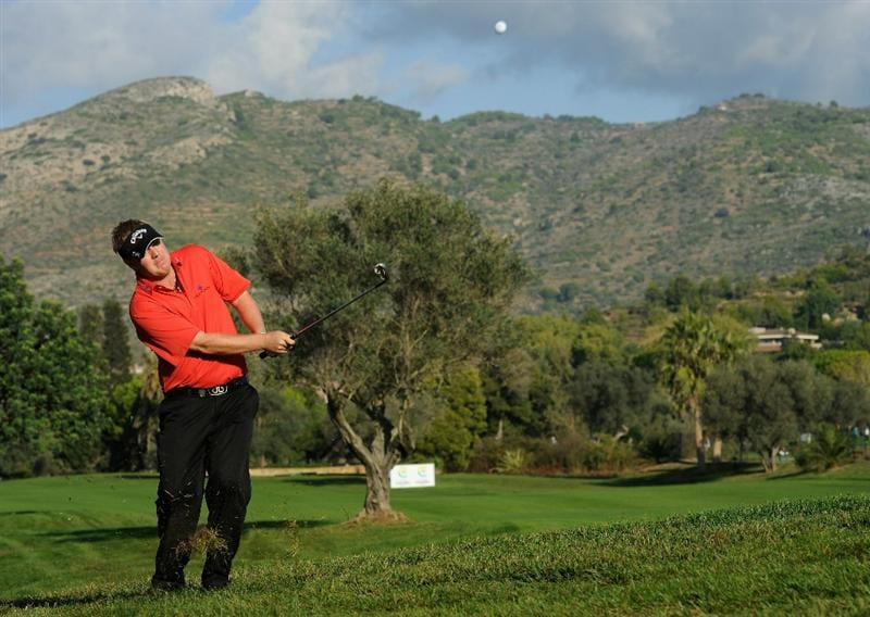 CASTELLON DE LA PLANA, SPAIN - OCTOBER 22:  Ross McGowan of England plays his approach shot on the 17th hole during the second round of the Castello Masters Costa Azahar at the Club de Campo del Mediterraneo on October 22, 2010 in Castellon de la Plana, Spain.  (Photo by Stuart Franklin/Getty Images)