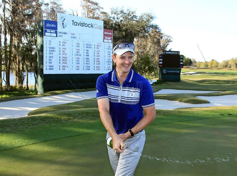 ORLANDO, FL - MARCH 23:  Justin Rose of England and the Lake Nona Team sprays the champagne at the 18th hole after the matches had finished with a win for Lake Nona during the second day's play in the 2010 Tavistock Cup, at the Isleworth Golf and Country Club on March 23, 2010 in Orlando, Florida.  (Photo by David Cannon/Getty Images)