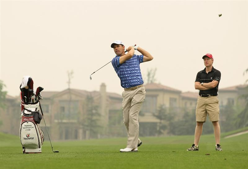 CHENGDU, CHINA - APRIL 20:  Padraig Harrington of Ireland plays a shot ahead of the Volvo China Open at Luxehills Country Club on April 20, 2011 in Chengdu, China.  (Photo by Ian Walton/Getty Images)